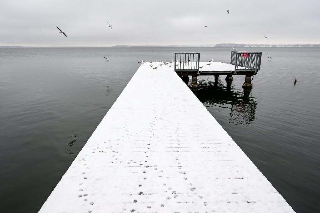 Snow-covered pier