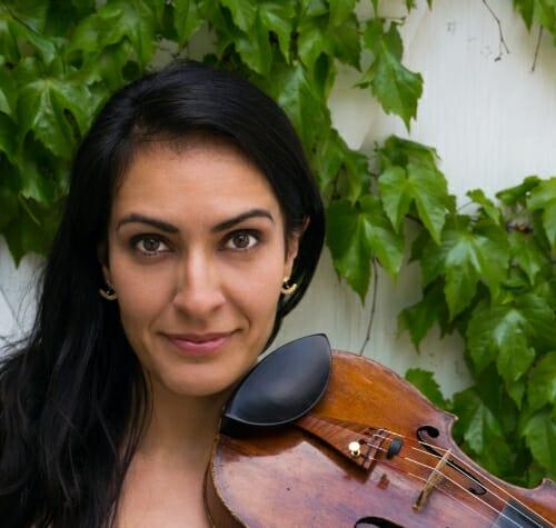 Paran Amirinazari holding a violin