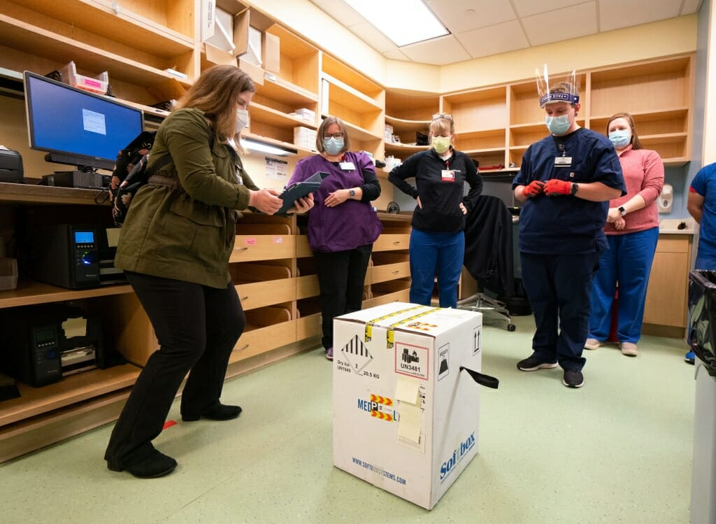 Elise Balzer from the Centers for Disease Control and Prevention documents that the box containing the vaccines arrived intact.