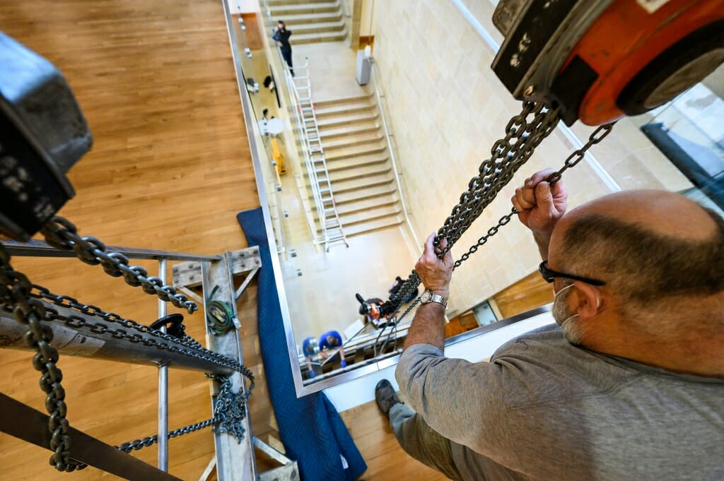 Roger Machin, with Methods & Materials Inc. of Chicago, operates the chains of the gantry.