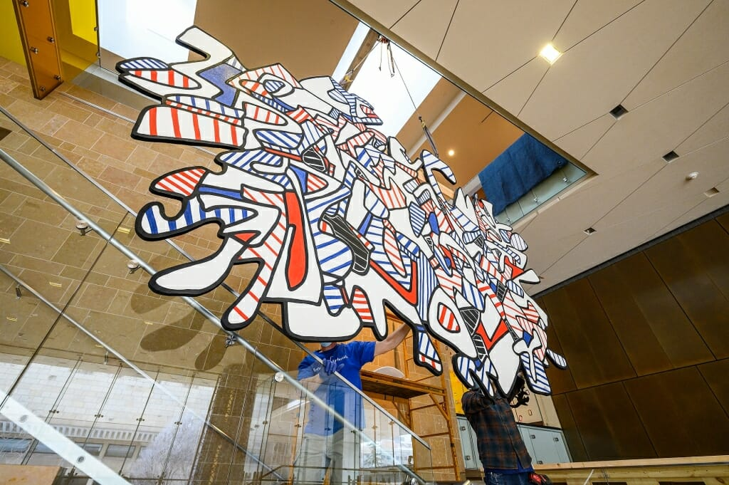 The nearly 15-foot wide painting,