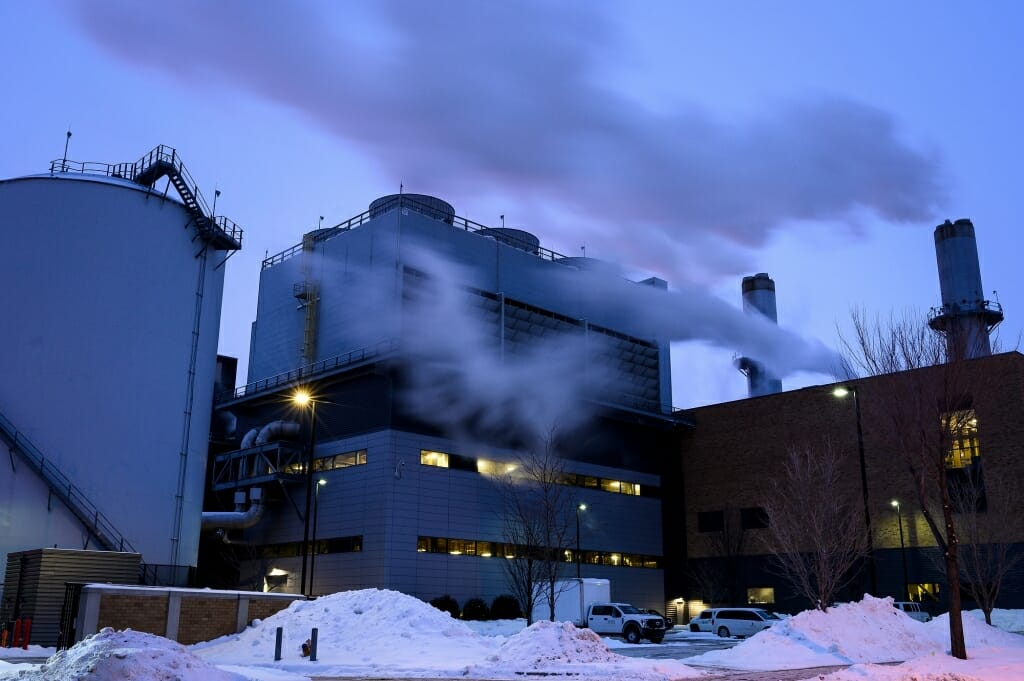 The snow-covered Charter Street Heating and Cooling Plant generates plenty of steam in the cold.