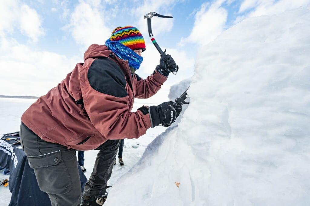 Lizz Epp, gear master for the Mountaineering Club, demonstrates how to climb ice.