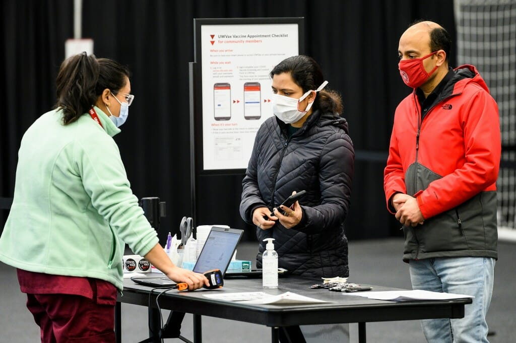 Photo of University Health Service medical assistant Sapana Shrestha checking in Garima Singh