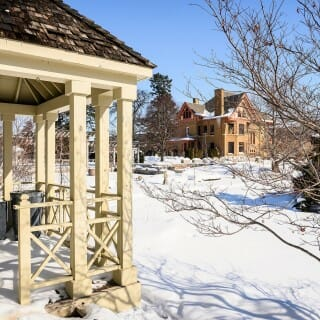 Allen Centennial Garden: Gazebo, snow-covered grounds and the historic Agricultural Dean's Residence.
