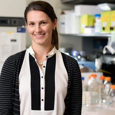 Portrait of Erin Lashnits standing in a lab