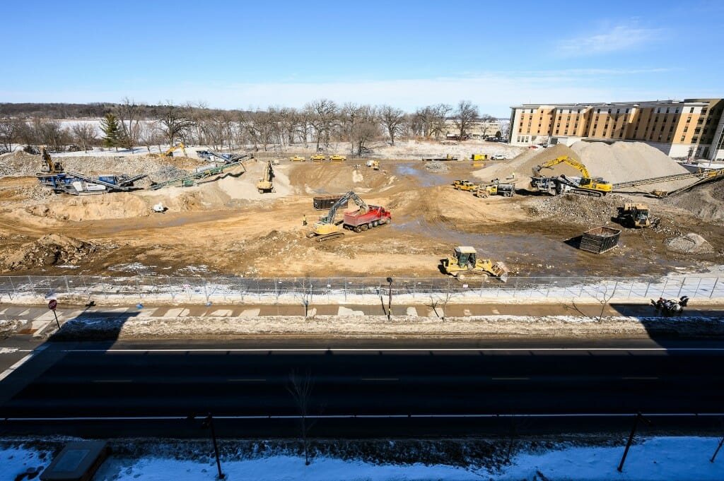 Construction workers use heavy equipment to grind remaining rubble piles from the demolished 1960s-era Natatorium. Construction of a new Natatorium is expected to begin in spring.