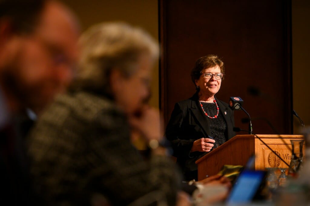 Blank speaking at a podium