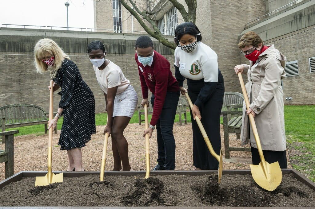 Vice Chancellor for Student Affairs Lori Reesor, undergraduates Nyla Mathis, Israel Oby and Kayla Cotton, and Chancellor Rebecca Blank hold shovels as part of a ground breaking event.