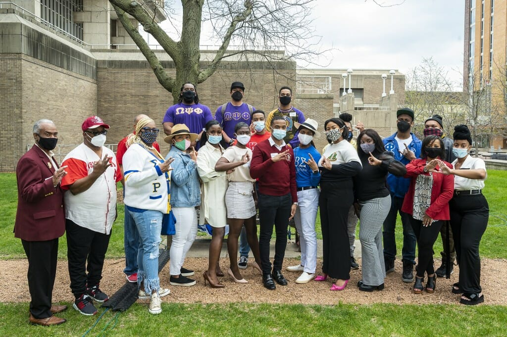 Attendees from Black Greek-letter fraternities and sororities gather during the ceremony.