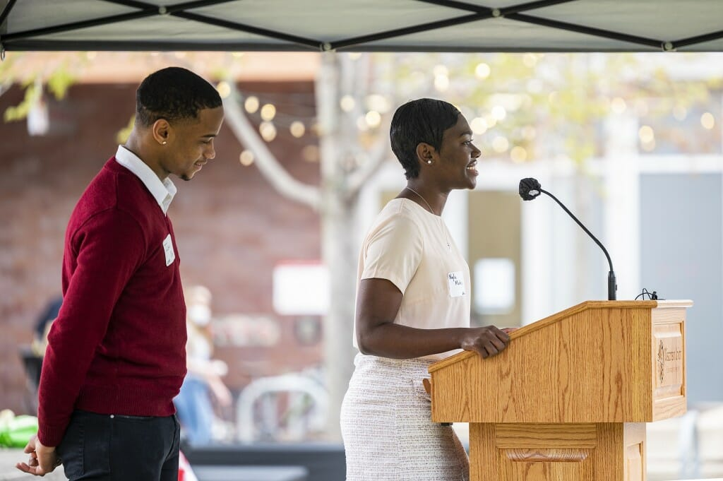 Undergraduates Nyla Mathis (right) and Israel Oby (left) address attendees.