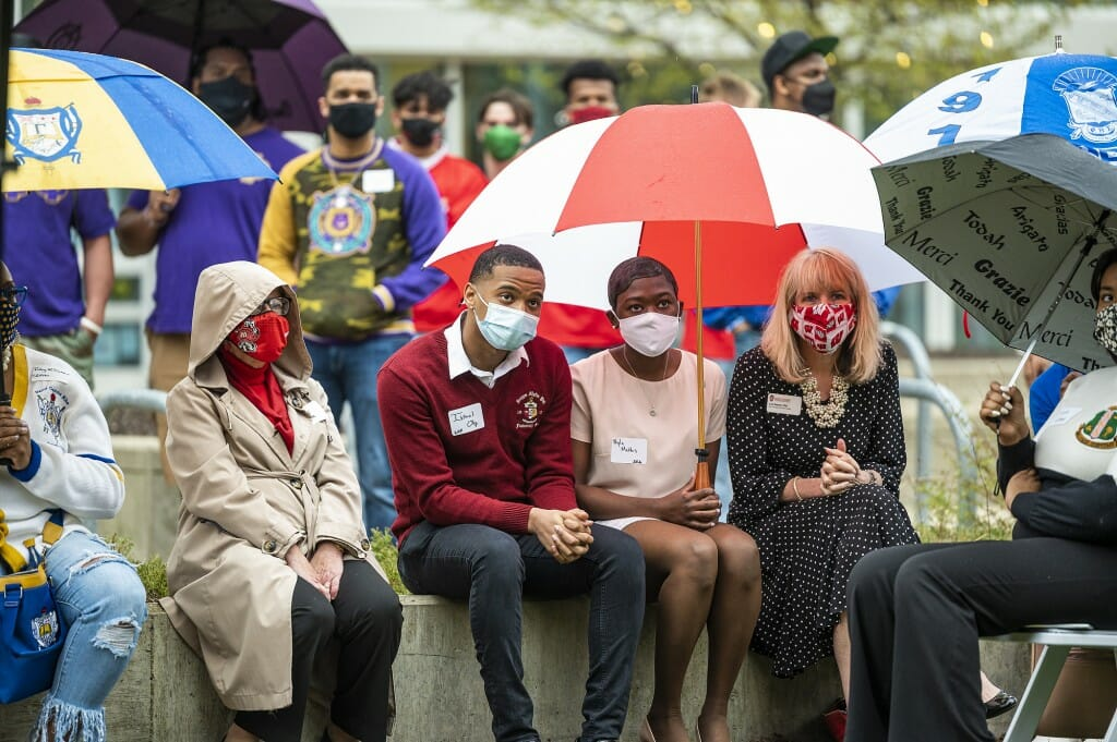 Chancellor Rebecca Blank, undergraduates Israel Oby and Nyla Mathis and Vice Chancellor for Student Affairs Lori Reesor (left to right), listen during the dedication ceremony.