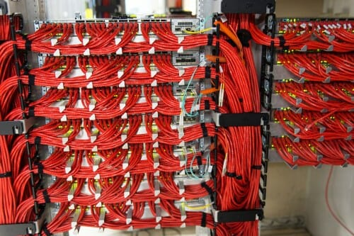 <p>Data Science is one of the most rapidly emerging career sectors in the nation, as it finds new uses for increased computing power is used across a wide variety of fields. Here, bundles of orange data cables connect arrays of computer servers in the Space Science and Engineering Center Data Center at UW-Madison.</p>