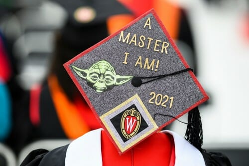 """A mortarboard with a picture of Yoda and the words """"A master I am!"""" 2021"""