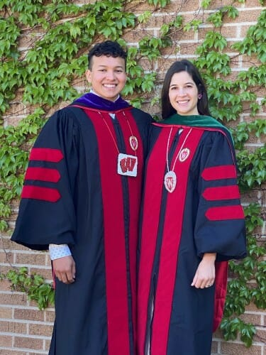 Photo of Gudino and Divine in their commencement robes