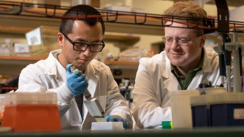 Lamming and Yu posing at a lab table