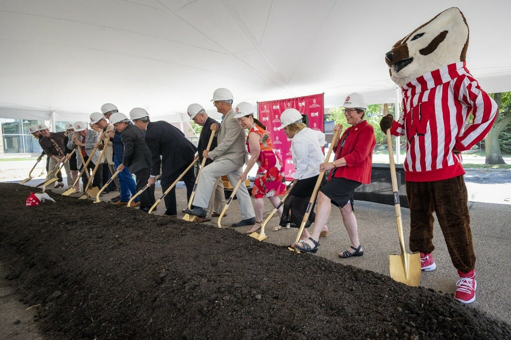 Bucky Badger and Chancellor Rebecca Blank stand with donors and other members of the campus and state community as they take shovels in hand during a UW School of Veterinary Medicine building expansion and renovation groundbreaking.