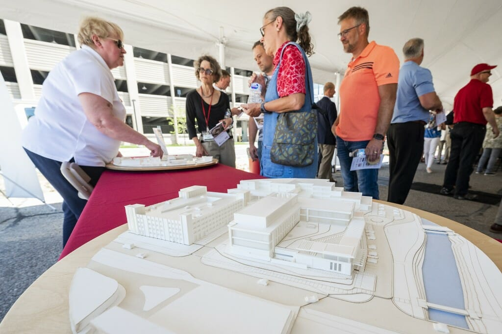 Marsha Callahan, senior development specialist in the School of Veterinary Medicine, shows off 3-D architectural models of the buildings.