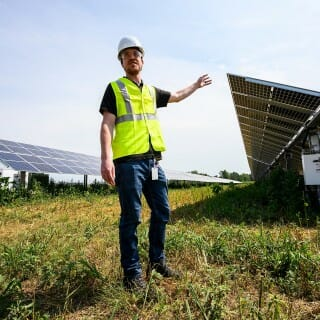 John Armstrong, a project manager with Madison Gas and Electric and 2012 alumnus of UW-Madison, leads a tour at O'Brien Solar Fields, which is the largest solar installation in Dane County. It's one of four projects MGE is working on under its Renewable Energy Rider.