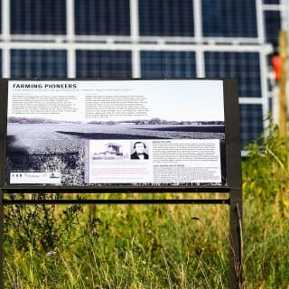 """The solar field is near the O'Brien family farmstead on what's known as Stoner Prairie. A sign nearby gives the story: """"The O'Brien family dairy has been part of Stoner Prairie since the early 1900s. In its early days the dairy housed an innovative milking parlor that became a dairy tour showcase and also served as a teaching center for the University Wisconsin–Madison School of Agriculture."""""""