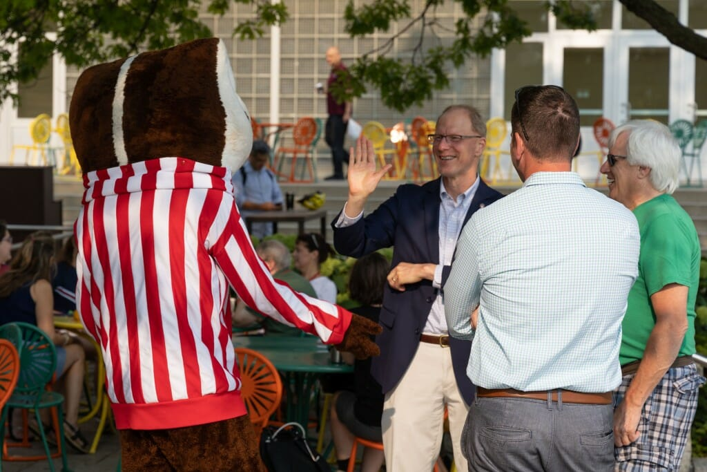 Bucky Badger has a conversation with some people.