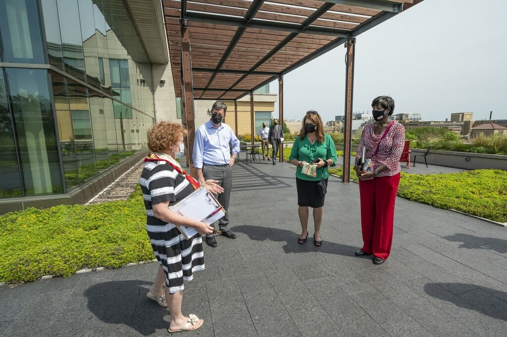 Linda Zwicker, senior assistant dean of communications and advancement in the School of Human Ecology, gives a tour of Nancy Nicholas Hall. From left are Zwicker, DOA Secretary Joel Brennan, DFI Secretary Kathy Blumenfeld and DSPS Secretary Dawn Crim.