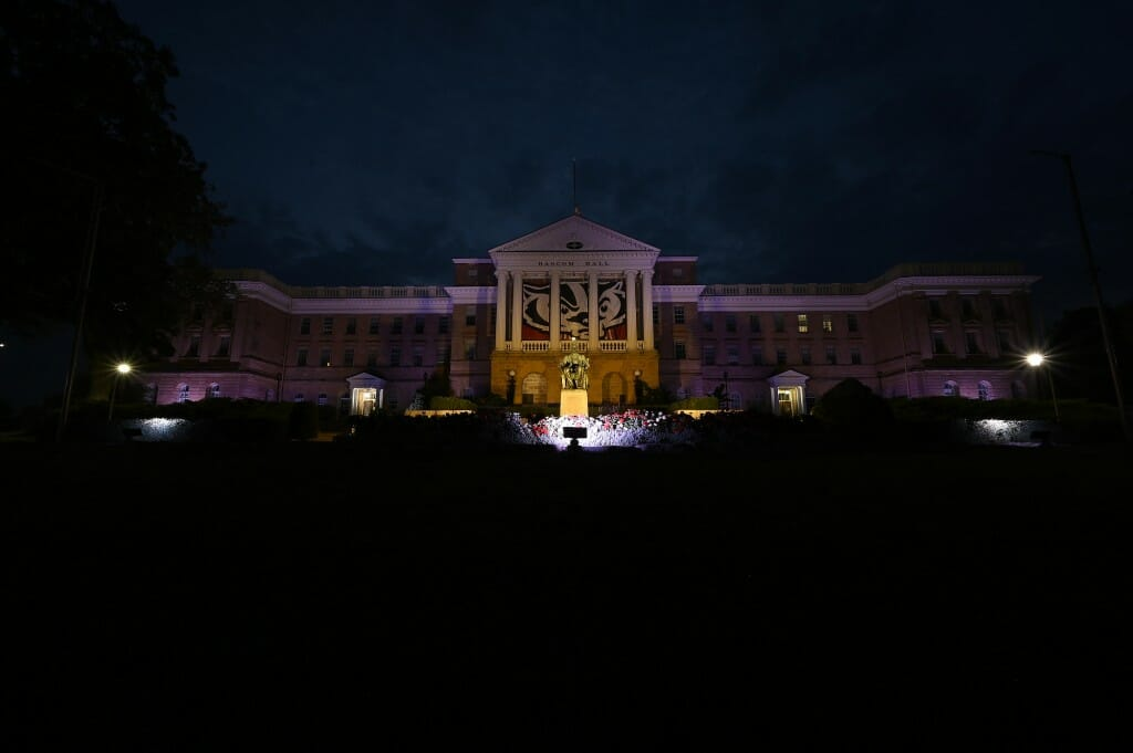 Bascom Hall is lit up in red, white and blue.