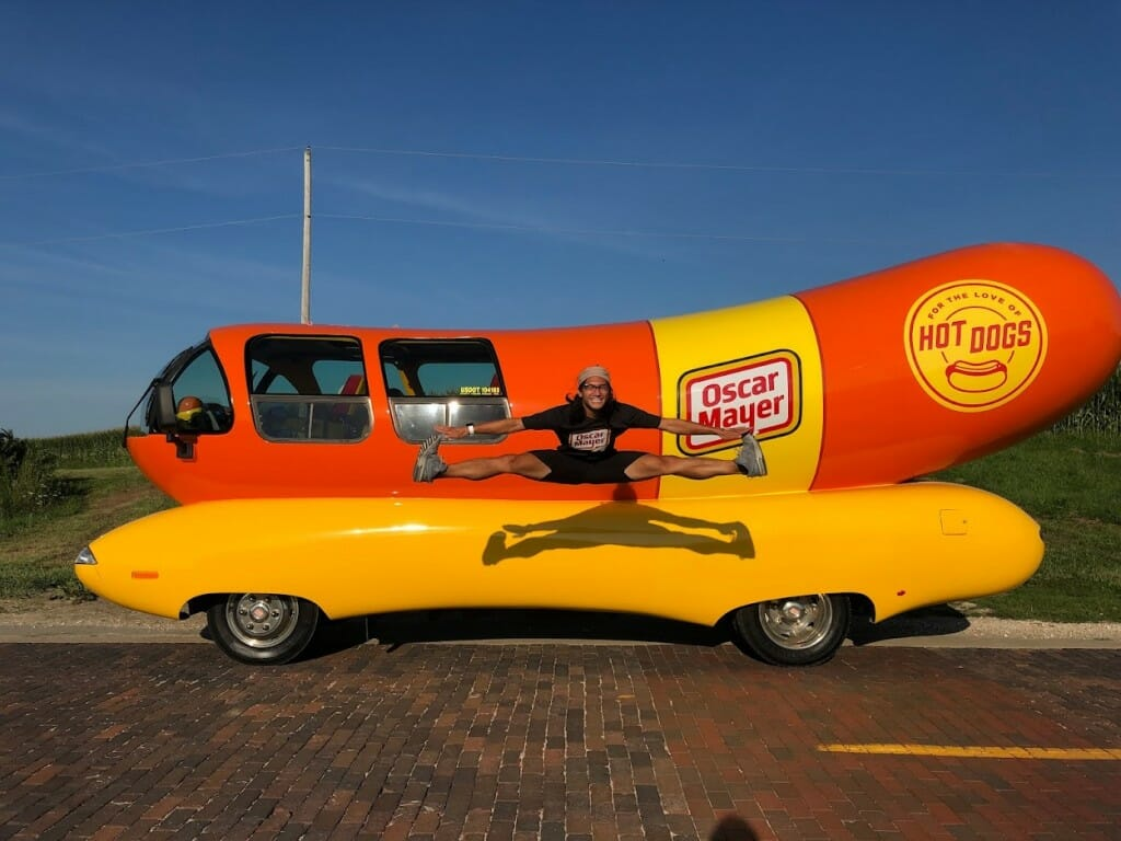 Zabat jumping in front of Wienermobile