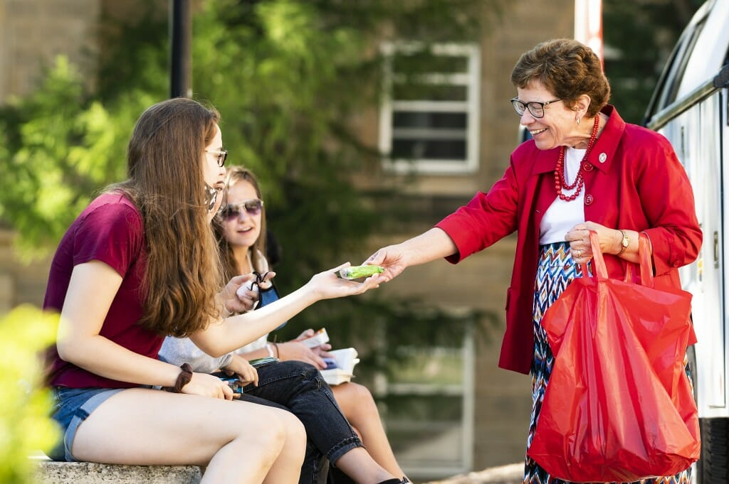 Chancellor Rebecca Blank hands out snacks to students waiting for class in front of Bascom Hall during the first morning of classes.