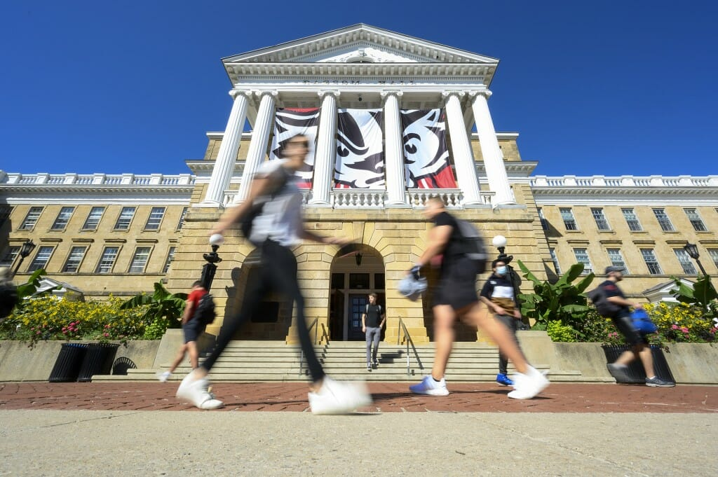 Students were greeted with a beautiful day as they walk in front of Bascom Hall during the first morning of classes for the fall semester on Sept. 8.