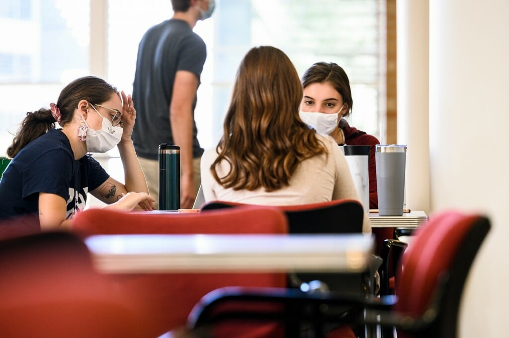 From left to right, Claudia Epland, Rachel Hawley (back to camera) and Makaila Wallin, all third-year doctoral students in the School of Pharmacy, study in a common area of Rennebohm Hall.