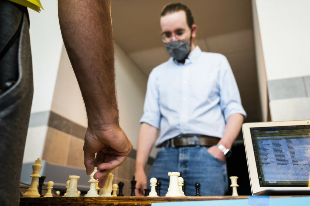 Jeff Covington, a graduate student, plays chess with prospective Chess Club members.