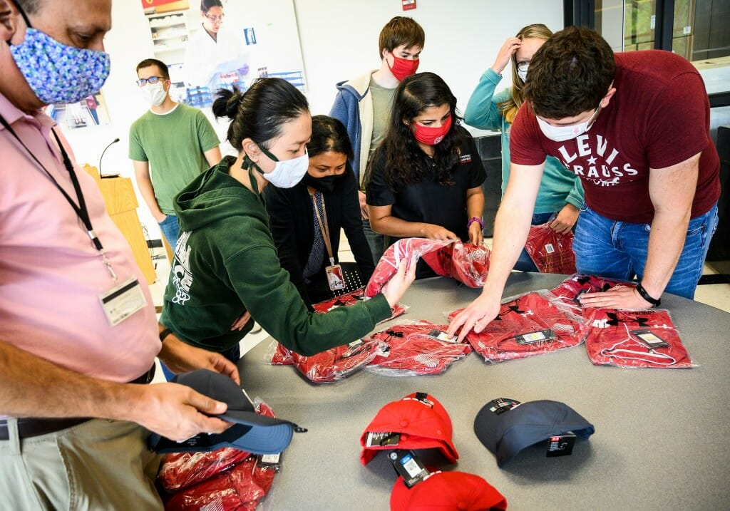 Wisconsin Veterinary Diagnostic Lab microbiologists and other frontline staff were given Wisconsin-branded merchandise by the Athletic Department.