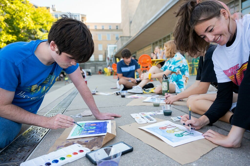 Students enjoy watercolor painting during The Terrace Paintacular, a part of the Labor Day Bash held at the Memorial Union.
