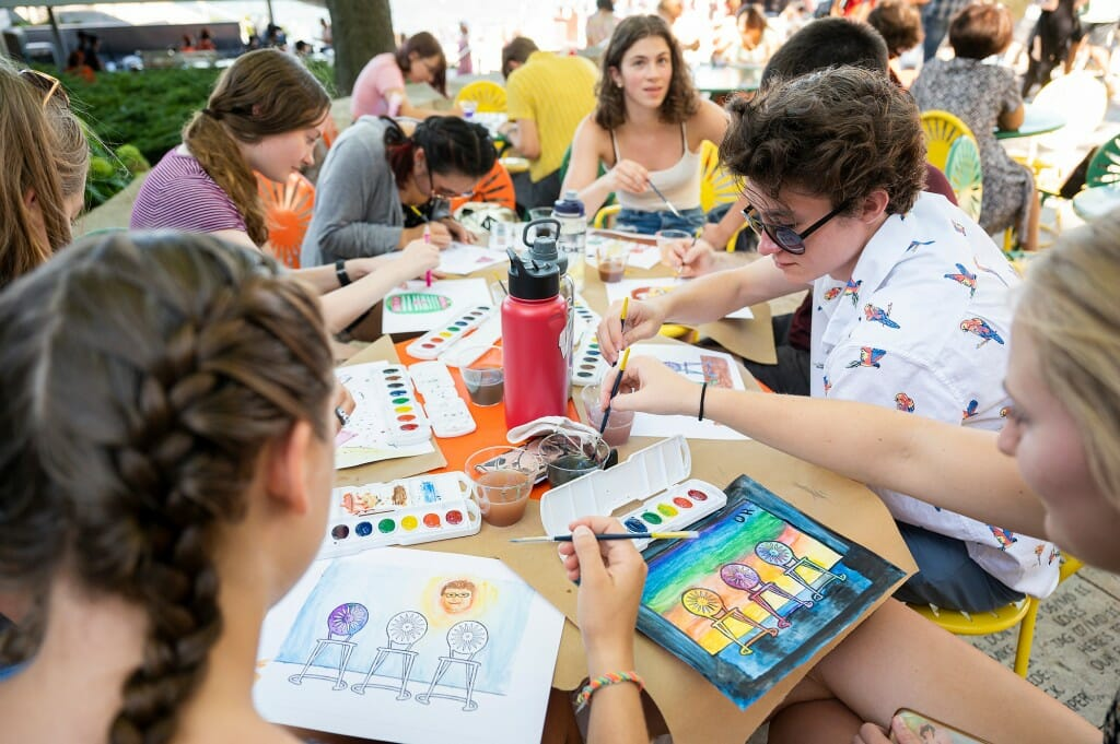 Students craft their masterpieces while enjoying the sun. The painting event was sponsored by Wheelhouse Studios at Memorial Union.