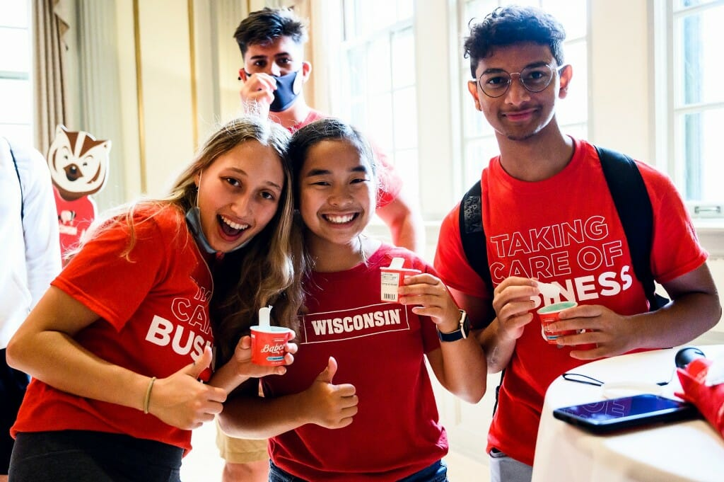 From left to right, first-year students Hannah Kimmel, Kendyl Johnson and Nirhankar Shylakumar enjoy cups of Babcock ice cream during a New Student Ice Cream Welcome event held in Great Hall in the Memorial Union on Sept. 3.