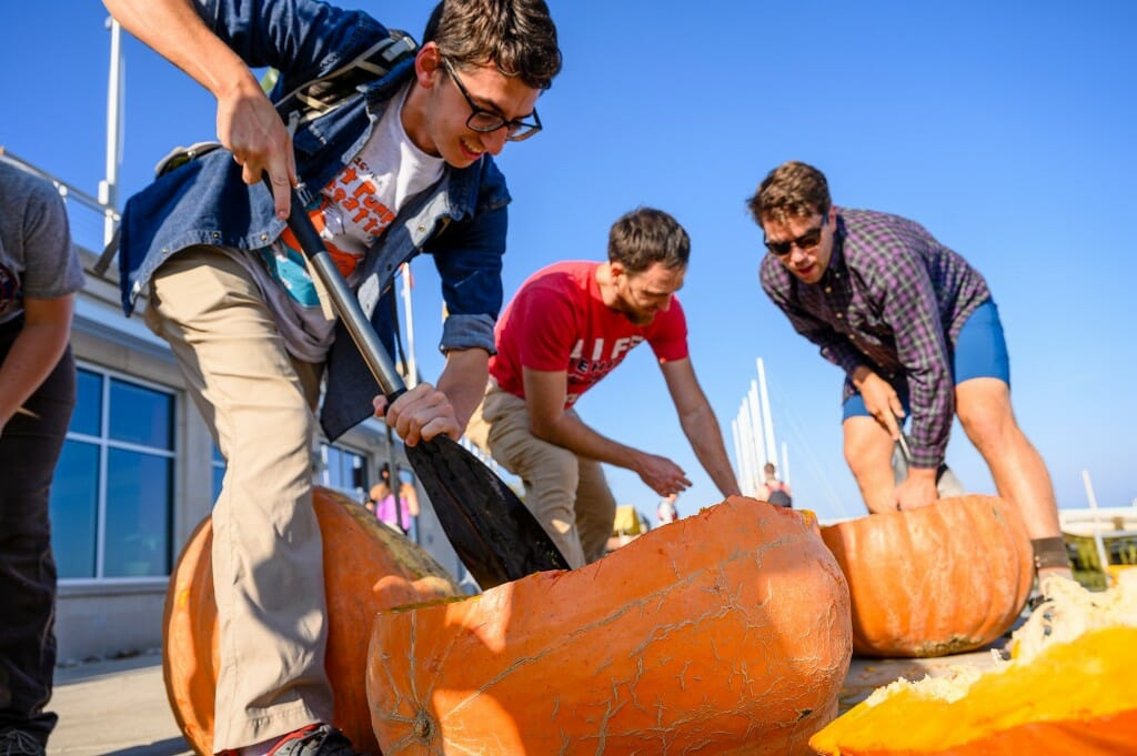 People carving a pumpkin