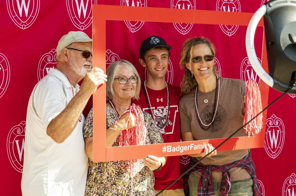 Jack Meyer, along with his mother and grandparents, smile for the camera in a photo booth outside Union South.