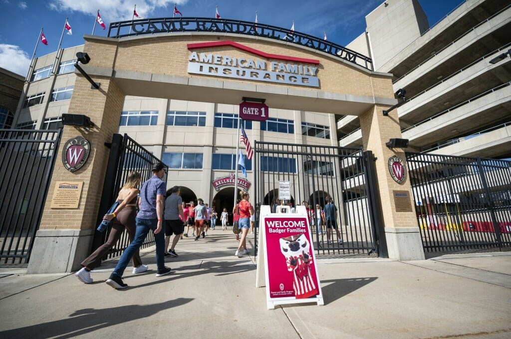 Families enter Camp Randall Stadium for a chance to walk out on the playing field and take photos.