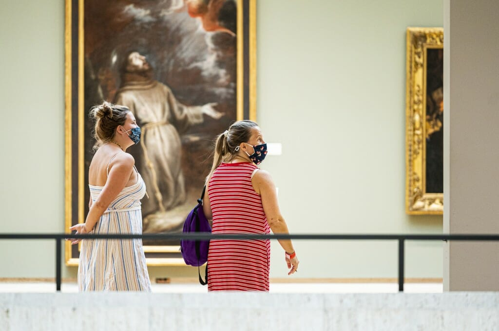 Student Elinor Picek and her mother Cherri Hill take part in a scavenger hunt at the Chazen Museum of Art.