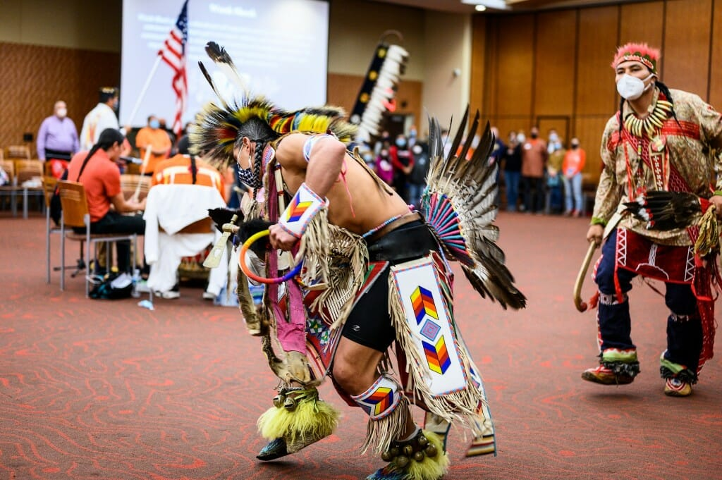 At center, dancer Josh Zunker of Ho-Chunk Nation performs with  those from several other tribes.