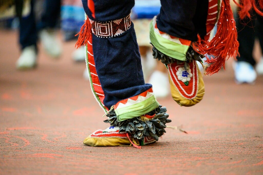 A dancer's beaded clothing and footwear.