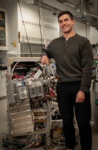 Novak standing next to equipment