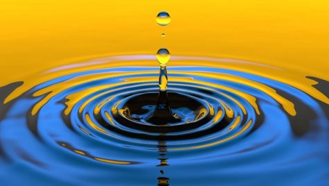 A drip making ripples in the water