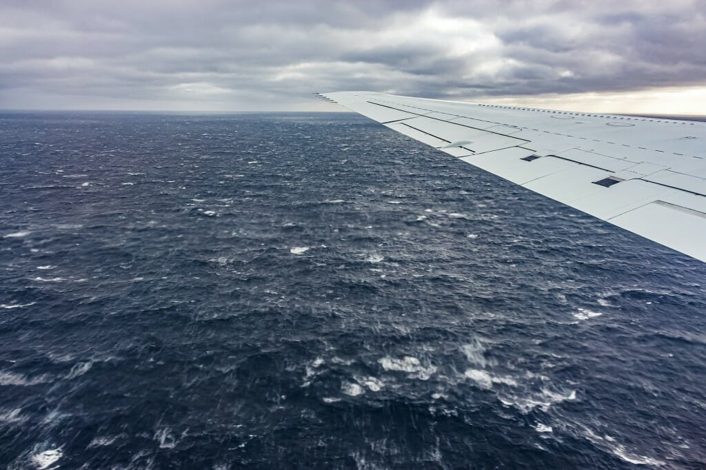 View of water and plane wing