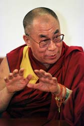 Dalai Lama speaks to reporters.