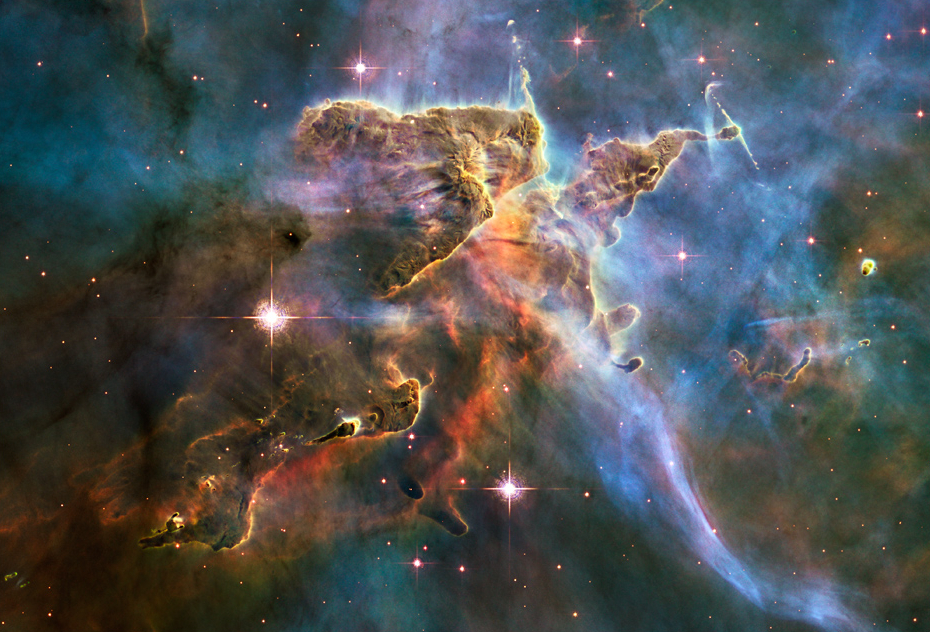 Hubble telescope image of stars forming inside a cloud of cold hydrogen gas and dust in the Carina Nebula