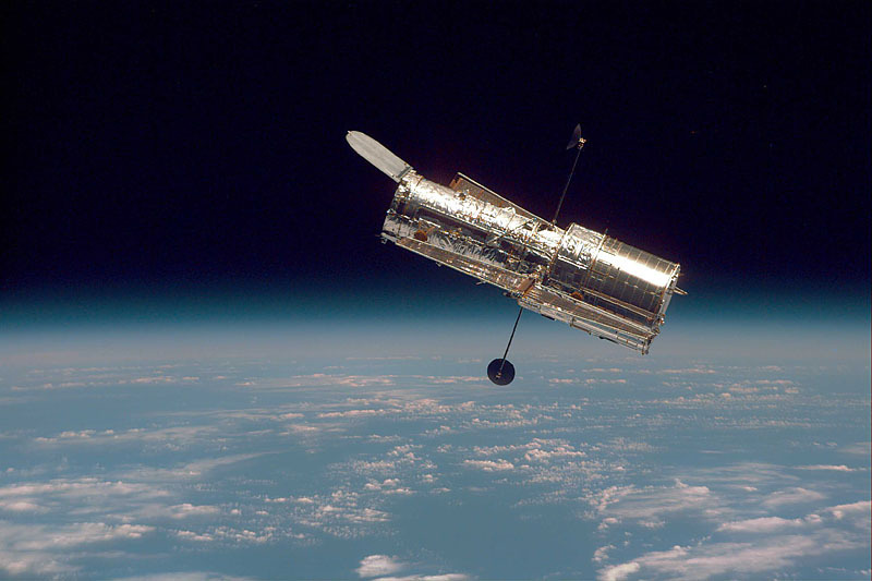 Photo: Hubble Space Telescope hovering over Earth