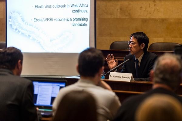 Photo: Yoshihiro Kawaoka conducting briefing
