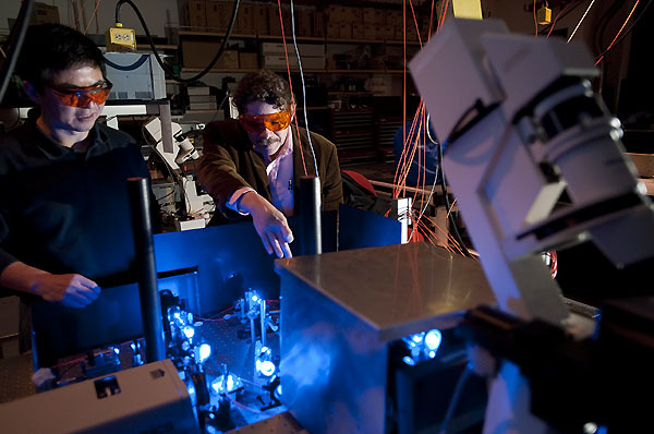 Photo: Researchers looking at laser